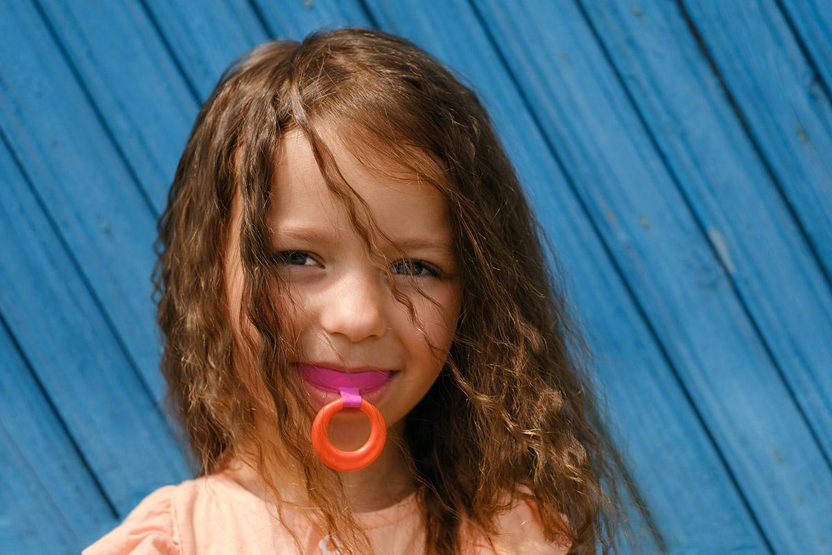 girl with vestibular hard mouth guard